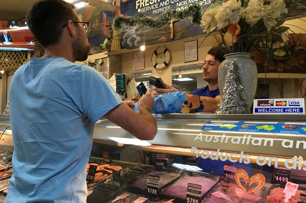 Scott at a seafood counter in Australia